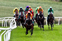 Tear Drops in the lead, finished 4th, Jockey Mr J P McKeown, Winner Stigh Collain 3rd from right partially hidden green yellow seams , Jockey Miss N Carberry - FT8E1775-e