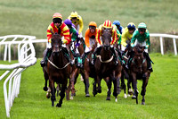 Tear Drops in the lead, finished 4th, Jockey Mr J P McKeown, winner Stigh Collain 3rd from right partially hidden green yellow seams , Jockey Miss N Carberry - FT8E1780-e