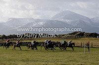 The start of Race 1 at Tyrella with the snow covered Mourne Mountains as a backdrop